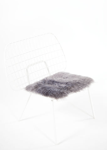 Shorn Silver Icelandic Sheepskin Chair Pad - Black Sheep (White Light)