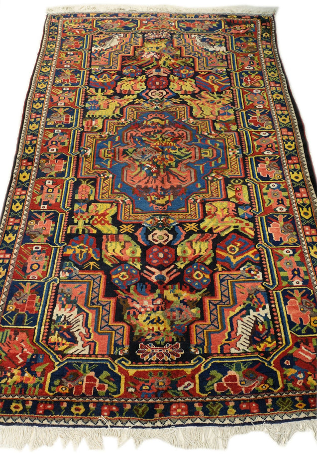 "5'4"" x 8'6""   Antique Persian Southern Bakhtiar Rug Angle View"