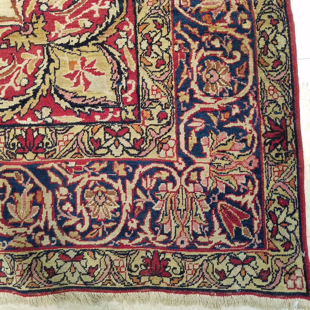 "4'10"" x 7'9""   Antique Persian Kerman Rug Angle View"