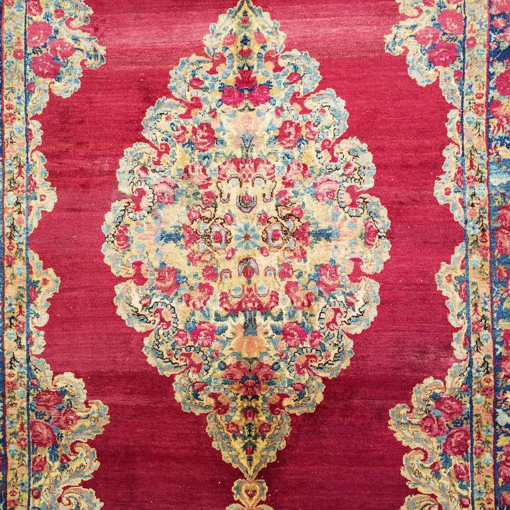 "4'4"" x 7'4""   Antique Persian Kerman Rug Angle View"
