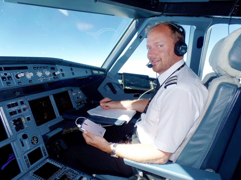 Titan Airways A320 First Officer Oliver Pickstock Holding the Zendure A5 during a Flight.