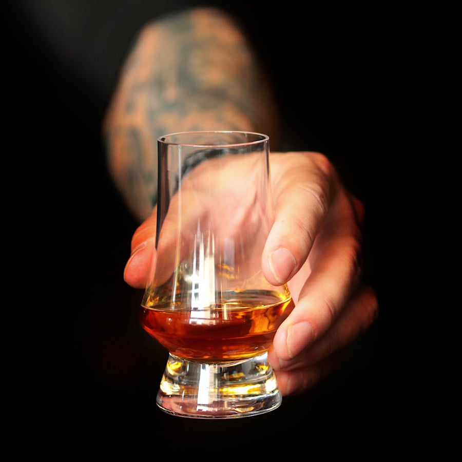 Hand holding glass. Wonders of Whisky. Modern Glencairn