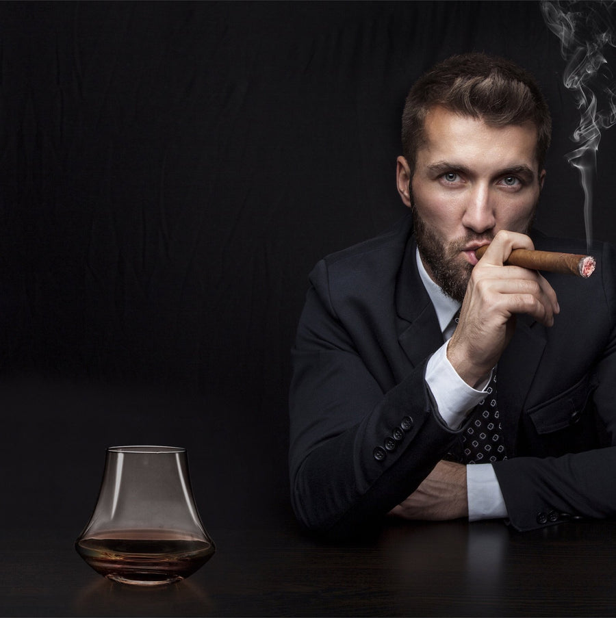 Cigar smoker with best whiskey glasses. Wonders of Whisky. Glass.
