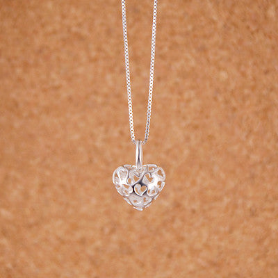 Heart With Cut Out Hearts Pendant