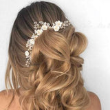 clay florals boho bridal white hair comb and earrings.