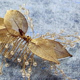 boho leaf hair comb for bride, boho wedding hairpiece by Green Alaska.