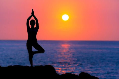 Silhouette of a yogi at sunset