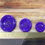 Purple clown buttons in sizes 37, 50 and 60.