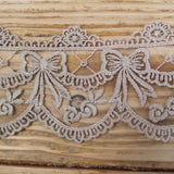 Embroidered lace bows - putty 70mm