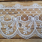 Embroidered lace bows - cream 95mm