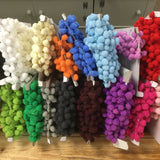 pom pom trim in a selection of colours