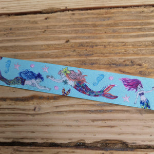 mermaid ribbon blue background