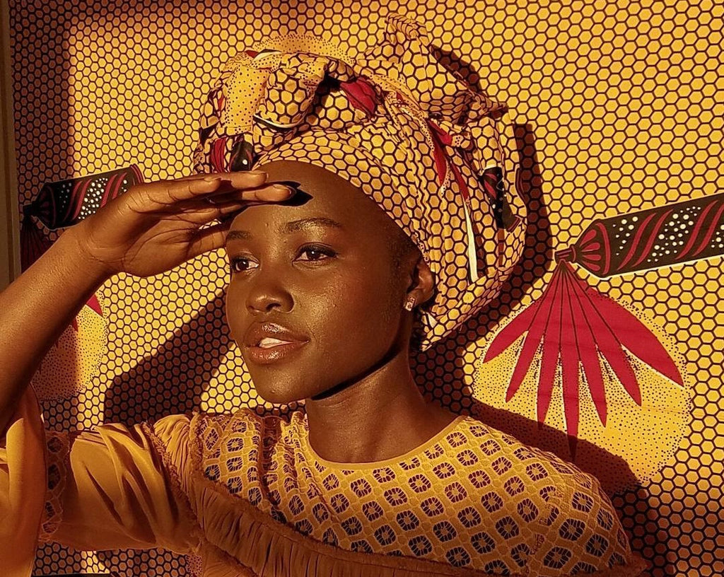 Lupita in yellow headwrap
