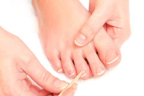 Remove or push the cuticles back