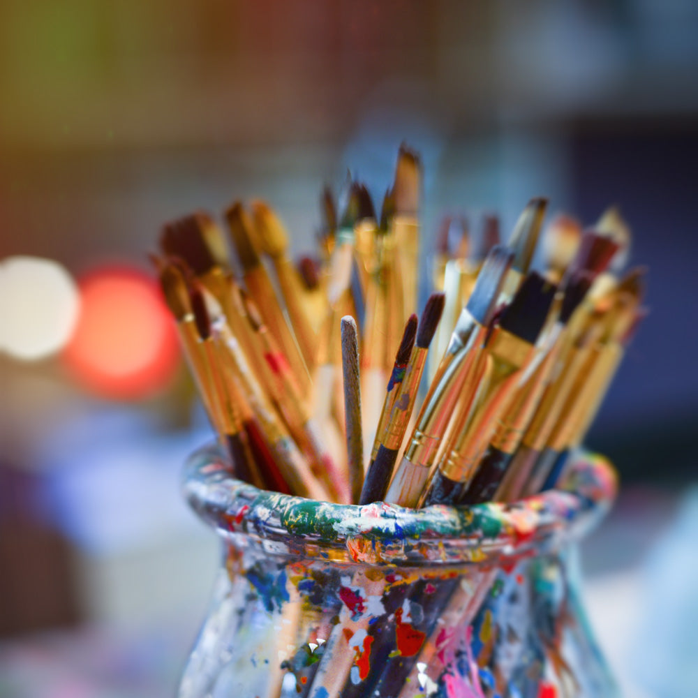 A jar of used paintbrushes to pair with a Chuck Close quote about creativity