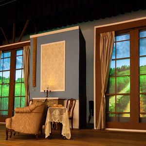 Pride and Prejudice high school performance with theatre projection backdrops