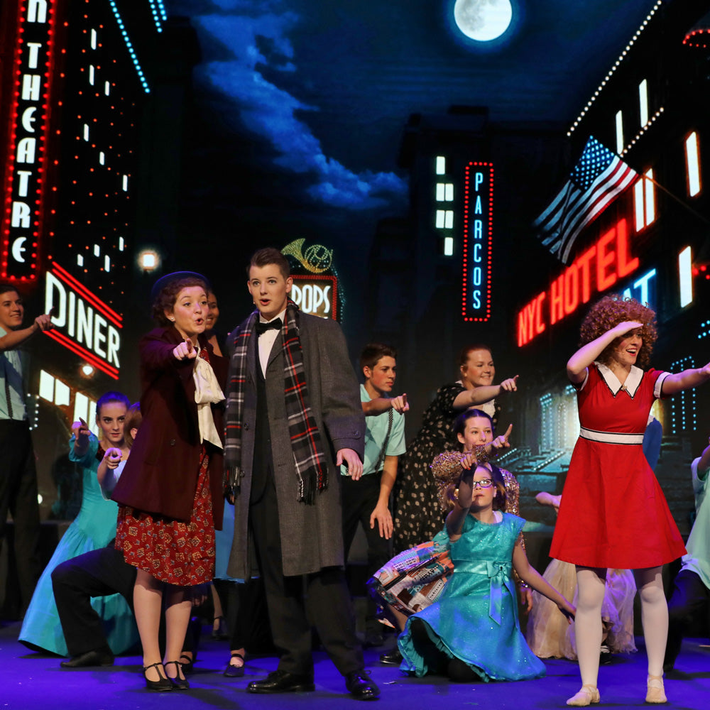 Stage rehearsal of Annie using digital projection backdrops by Theatre Avenue