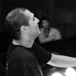 Theatre director and teacher Robert Botello smiles during a rehearsal