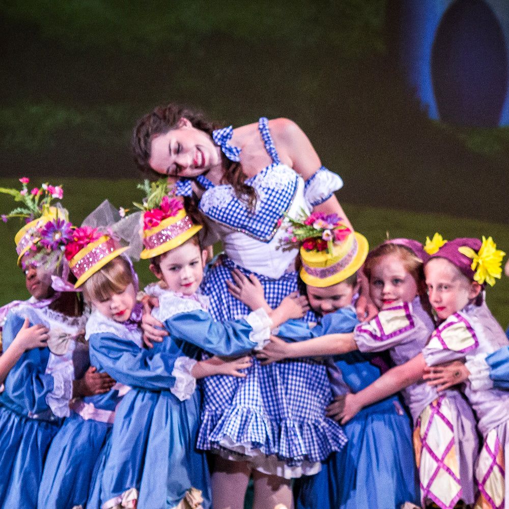 Dorothy played by Avery McGee, with her munchkin friends, at the Savannah Ballet