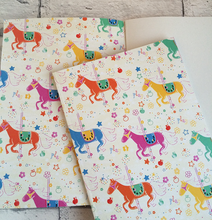 Load image into Gallery viewer, Notebook with carousel horses illustration