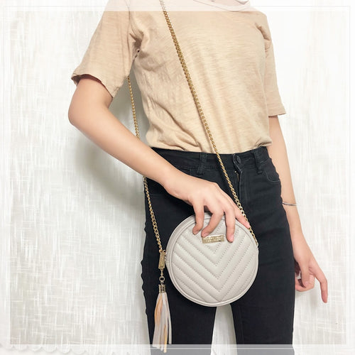 Women's Small Round Crossbody Bag with Tassel