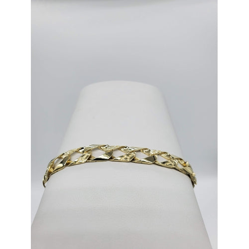 10kt Yellow Gold 9mm Wide Oval Shape High Polish and Nugget Pattern Bracelet (32183)