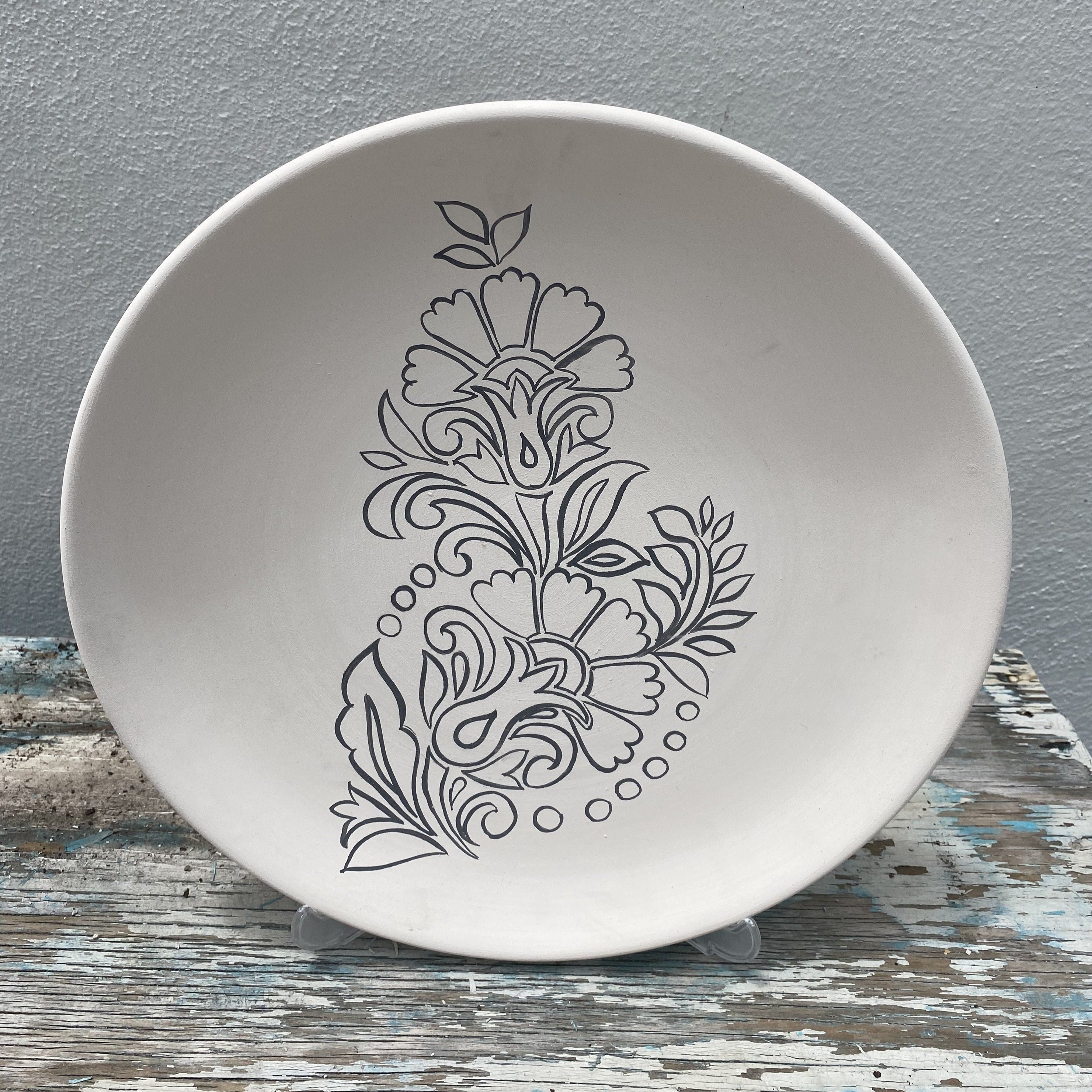 Scalloped plate with Carnation