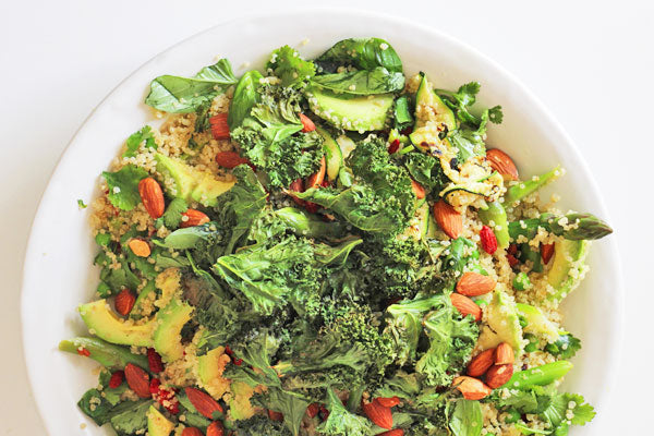 Spring vegetable salad with crispy kale
