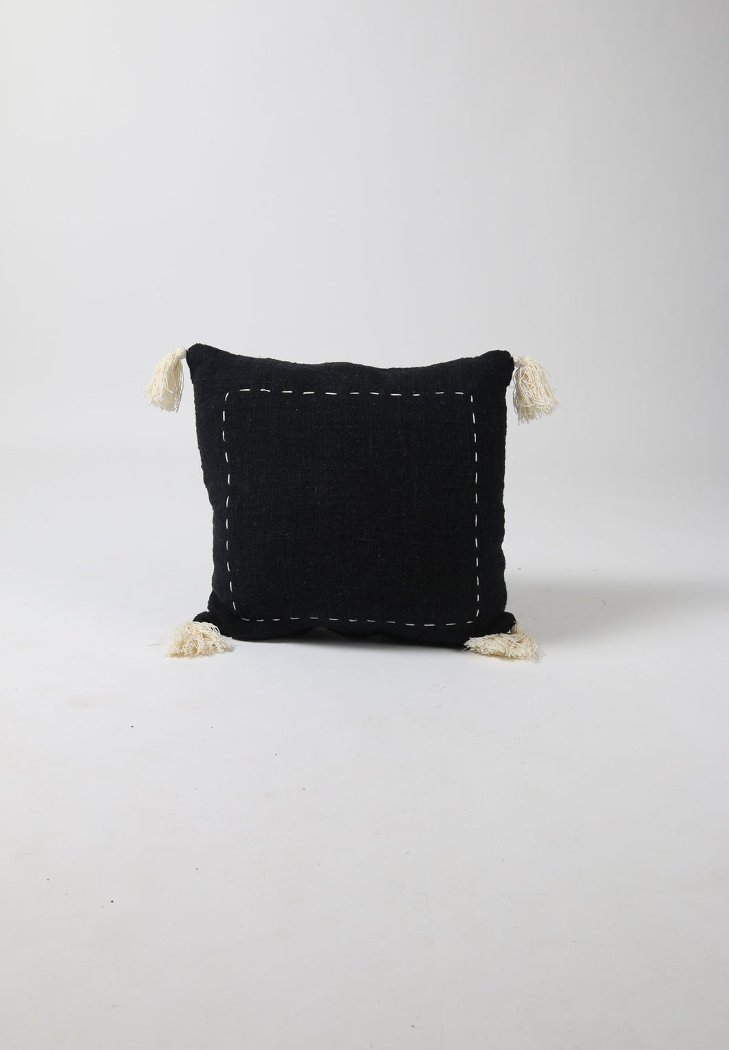 Black Cotton Cushion with Cream Stitching and Corner Tassels