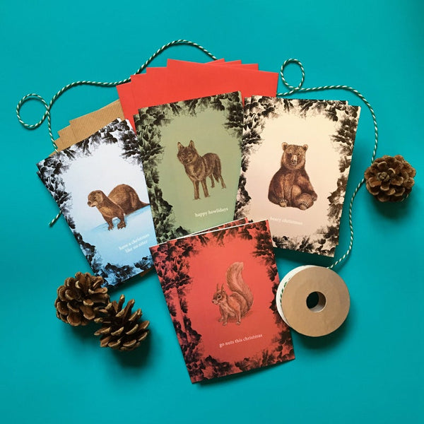 Illustrated Animal Christmas cards. 4 designs. Designed using Watercolour and Ink. Christmas Bear, Otter, Wolf and Squirrel. MarcoLooks