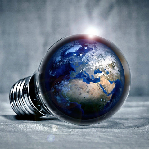 Image of the earth in a lightbulb