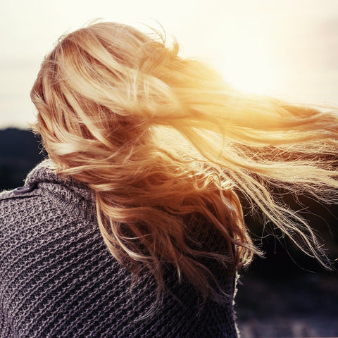 Long hair in the sunlight blowing in the wind