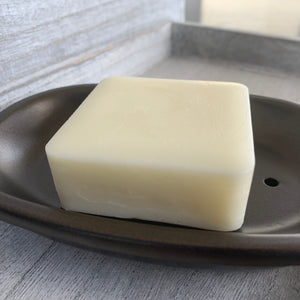 image of natural conditioner bar in sandalwood lime scent, by pickle and bee natural products, unwrapped