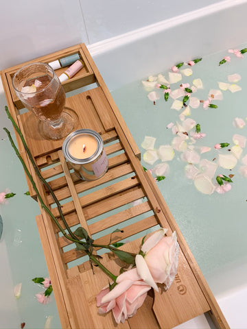 bath rack with candle and wine