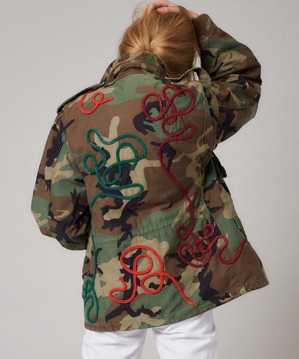 Customised vintage camo parka jacket with elaborate swirls of richly coloured braided cord
