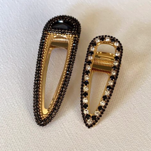 Style your hair with these beautiful duo rhinestone clips. It is the perfect accessory to any outfit! Large clip is black in colour and smaller clip is black with clear rhinestones. Can be worn each as a single clip or together. You can also mix and match with another favourite clip of yours!  Two pieces