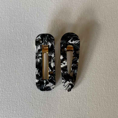 Style your hair with these beautiful duo clips. It is the perfect accessory to any outfit! Both clips are a beautiful black/white colour. Can be worn each as a single clip or together. You can also mix and match with another favourite clip of yours!  Two clips