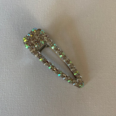 Style your hair with this beautiful rhinestone clip. It is the perfect accessory to any outfit! This clip has iridescent rhinestones. Can be worn each as a single clip or together. You can also mix and match with another favourite clip of yours!
