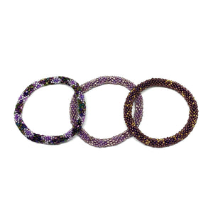 "These ""Gooseberry Roll Ons"" come as a set of three.  They are handmade with love by women artisans in Nepal, using high quality glass beads and hand-dyed cotton thread. These bracelets will expand over your hand to fit most wrist.   The purchase of these bracelets empowers female artisans through fair trade."