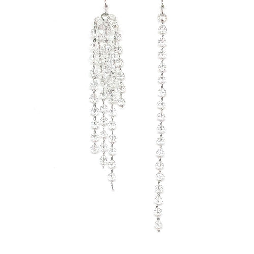 These asymmetrical crystal earrings can be worn with a bridal gown or for an evening out. Size: 9 cm and 11 cm  These earrings are rhodium plated.  Lead, nickel and cadmium free  Crystal, Rhinestones