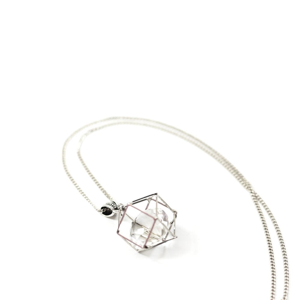 BEST SELLER! Last one available  This beautiful handmade floating crystal necklace has a large Chinese Crystal encased in a white gold plated cage. The 28 inch chain is white gold plated with a toggle clasp.  This necklace is lead and nickel free and is tarnish resistant.  Designed and handcrafted by Canadian Artisan