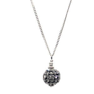 "This beautiful handcrafted glitter ball necklace has a black chandelier ball which is white gold plated with Czech crystals.  The finishings are all white gold plated.  This necklace is rhodium plated and 26"" in length with a toggle clasp  This necklace is lead, nickel free and tarnish resistant  Designed and handcrafted by Canadian Artisan"