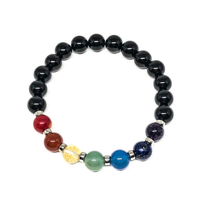 9 mm gemstones align to each Chakra, each is seperated by a tiny silver coloured bead. The Chakra beads consist of red coral, carnelian, treated citrine, green aventurine, blue quartz, lapis lazuli and amethyst. This stretchable bracelet is accented with black onyx beads.Includes:  1 bracelet, 18 cm in circumference with stretch cord, 9 mm beads