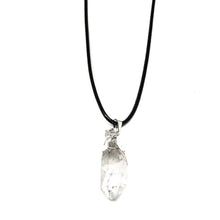 "Load image into Gallery viewer, As a healing stone, it is known as the master stone, once thought to be solidified light. Special characteristics of storing (programming), amplifying and transmitting thoughts and energy. It is said to activate the pineal and pituitary glands. Quartz is excellent for meditation and accessing the higher self and guides.  This necklace comes with a black cord chain and is 17"" length with a 2"" extender."