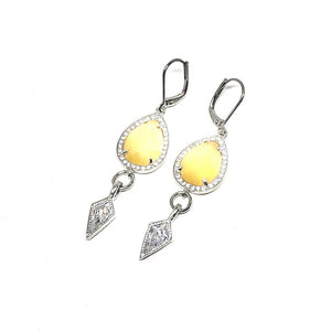 These beautiful earrings are perfect to wear with any outfit or with our matching necklace.   Yellow agate crystals surrounded with czech crystals   Each earring has a drop cubic zirconia   White gold plated frenchback closures   Hypoallergenic