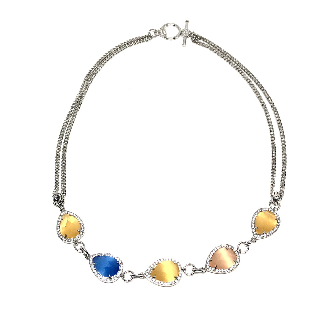 This beautiful short necklace has Blue Agate, Yellow Agate crystals surrounded by beautiful Czech crystals.  The length of this necklace is 16 inches  Chain is rhodium plated  Designed and handcrafted by Canadian artisan