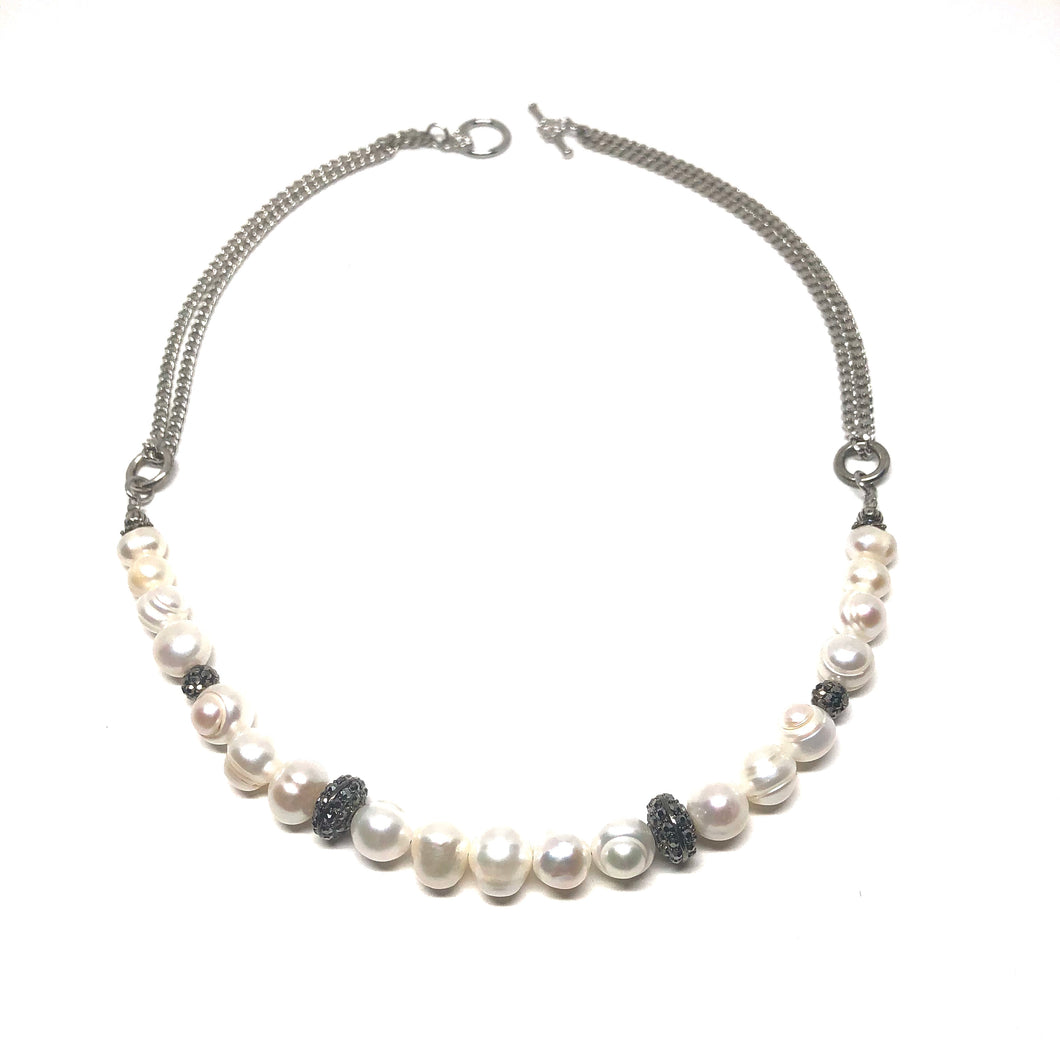 "This stunning handcrafted genuine freshwater pearl necklace is designed to enhance your evening wear dress.  This necklace has czech crystals set between the freshwater pearls  This necklace is 20"" in length and is rhodium plated  Designed and handcrafted by Canadian artisan"