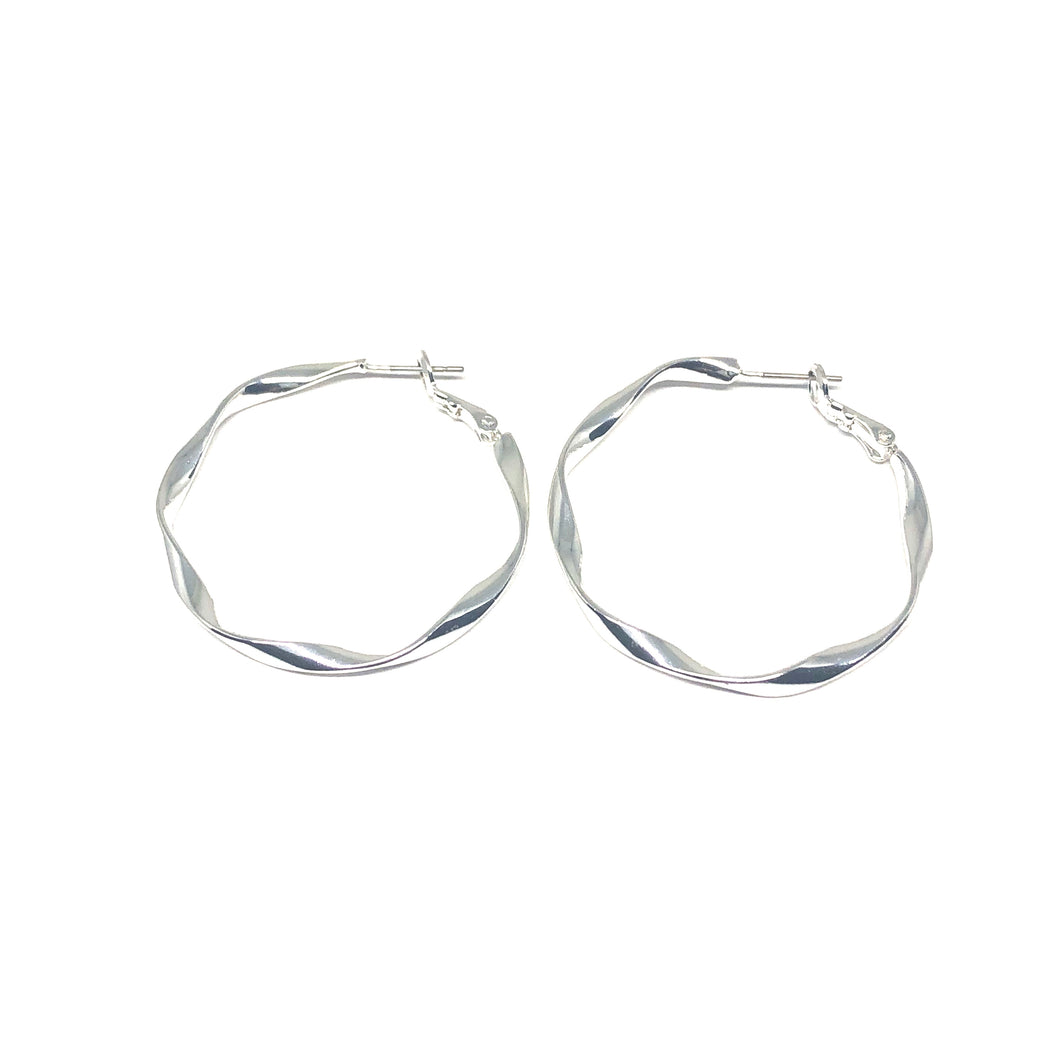 Exclusively designed and handmade in Spain, these eye-catching earrings are straight off the runways. Indulge in the high fashion experience when you accessorize your outfit with these statement pieces. Luminously sterling silver plated; comfortably ultra lightweight; accented to adorn any and every attire! Manufactured in compliance with the European Standards ― nickel and lead free.  Hypoallergenic   These hoop earrings are 40mm in size