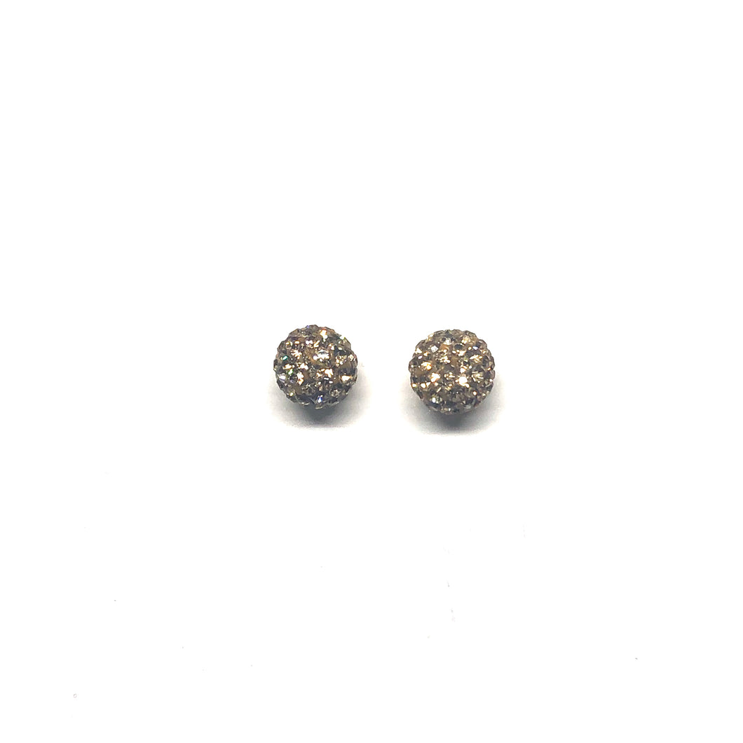 These genuine light topaz swarovski crystal studs are hand set in a clay base.  The post and backs are sterling silver   Hypoallergenic, lead and nickel free