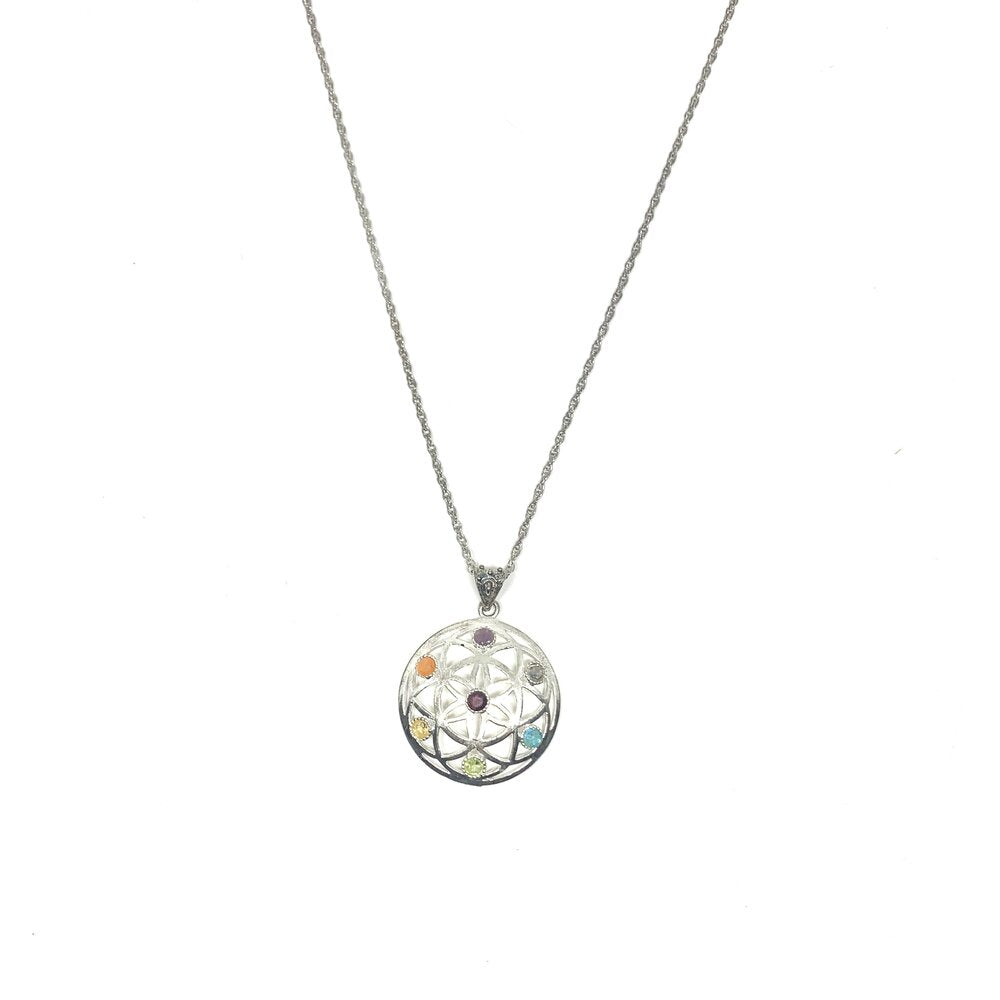 This eye catching silver coloured nikel free alloy pendant comes from India. Gemstones which represent the chakra system include garnet, light and dark treated citrine, peridot, aquamarine, iolite, amethyst and dark blue quartz.The length of this necklace is 34cm including the Seed of Life Pendant.  Seed of Life Pendant is 4cmx4cm